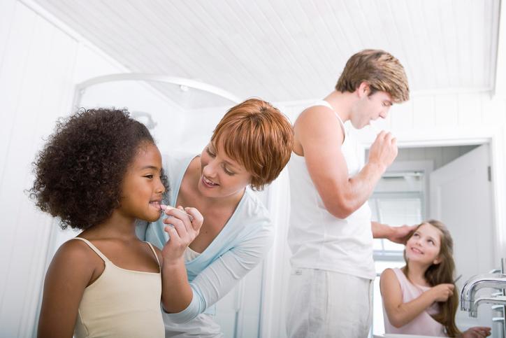 Family grooming in bathroom